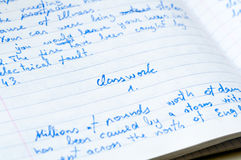 Classwork exercise-book. Messy page of an exercisebook with english lesson classwork containing mistakes Royalty Free Stock Photography