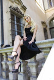 Classy Black. Beautful model posing in a classy black outfit Stock Image
