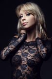 Classy blonde in lace dress Royalty Free Stock Photo