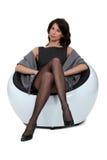 Classy brunette wearing stockings Stock Photo