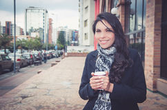 Classy brunette woman wearing dark coat and white Royalty Free Stock Images