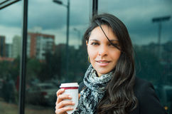 Classy brunette woman wearing dark coat and white Stock Photography