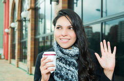 Classy brunette woman wearing dark coat and white Royalty Free Stock Photo