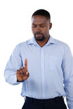 Classy businessman looking his finger. Against white background Royalty Free Stock Images