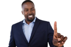 Classy businessman pointing his finger while talking. Against white background Royalty Free Stock Images