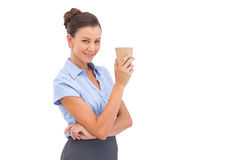 Classy businesswoman holding coffee cup Stock Image