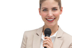 Classy businesswoman holding microphone. On white background stock photography