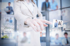Classy businesswoman presenting coworkers pictures royalty free stock image