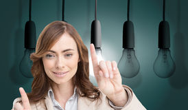Classy businesswoman touching invisible screen. Composite image of classy businesswoman touching invisible screen Royalty Free Stock Photography