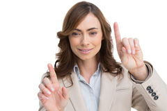Classy businesswoman touching invisible screen Royalty Free Stock Photos