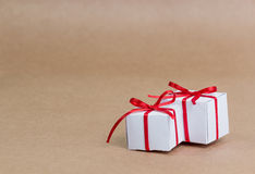 Classy Christmas gifts box presents on brown paper Royalty Free Stock Photography