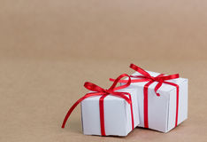 Classy Christmas gifts box presents on brown paper Royalty Free Stock Photos
