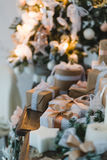 Classy Christmas hand made gifts box presents with brown bows. Selective focus Stock Photos