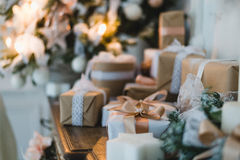 Classy Christmas hand made gifts box presents with brown bows. Selective focus Stock Photography