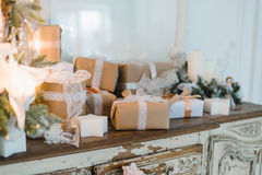 Classy Christmas hand made gifts box presents with brown bows. Selective focus Stock Photo