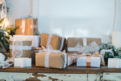 Classy Christmas hand made gifts box presents with brown bows. Selective focus Stock Images