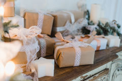 Classy Christmas hand made gifts box presents with brown bows. Selective focus Royalty Free Stock Images