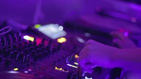 Classy DJ hands movement during party in night club. Stock footage stock footage