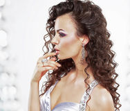 Classy Elegant Woman with Jewelry - Platinum Ring and Earrings. Frizzy Hairstyle Stock Photo