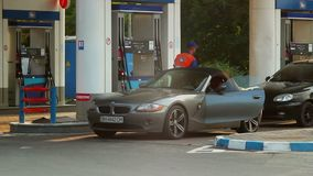 Classy elite car drives to gas fueling station, gasoline petrol. Stock footage stock footage