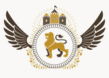 Classy emblem made with bird wings decoration, wild lion   Royalty Free Stock Photos
