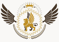 Classy emblem made with bird wings decoration, wild lion. Classy emblem made with bird wings decoration, wild lion and monarch crown symbol. Vector heraldic Royalty Free Stock Image