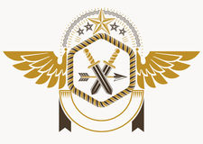 Classy emblem made with eagle wings decoration, armory and stars Royalty Free Stock Photography