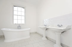 Classy family bathroom with free standing bathtub Stock Photography