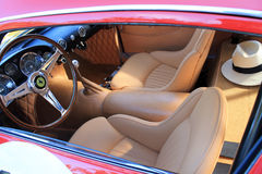 Classy ferrari interior and a hat Royalty Free Stock Images