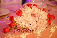 Classy floral arrangement in a pastel oval bouquet featuring pink hydrangeas and red roses. Horizontal perspective of classy floral arrangement in a pastel oval stock photos