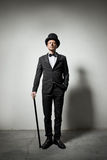 Classy gentleman. With bowler hat and cane looking confidently at camera Royalty Free Stock Photo
