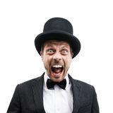 Classy gentleman. Vintage gentleman with bowler hat and bow tie screaming at camera Royalty Free Stock Photo