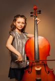 Classy girl with long hair holding cello to play Stock Images