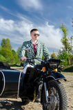 Classy guy on a motorcycle. With a sidecar Stock Photo