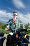 Classy guy on a motorcycle Stock Photo