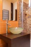 Classy house - bathroom eguipment. Classy house - round vessel sink in a modern bathroom Stock Image