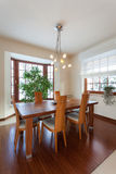 Classy house - dining room. With brown wooden table stock photos