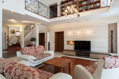 Classy house - elegant living room. And a mezzanine Royalty Free Stock Image