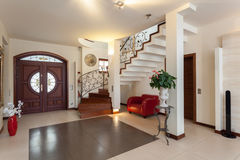 Classy house - entrance. Living room and staircase royalty free stock images