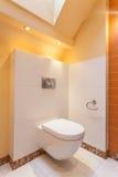 Classy house - toilet. Classy house - White and orange toilet room Royalty Free Stock Photo