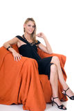 Classy lady in arm chair Stock Photo