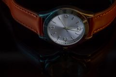 Classy Leather Watch Reflected on Black Table Stock Photo
