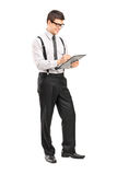 Classy man writing on a clipboard Stock Photography