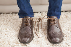 Classy mans shoelaces tied together Stock Photo