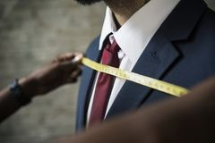 Classy man in the tailor shop service Stock Photos