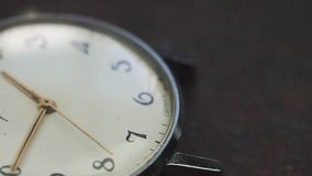Classy old watch lies on wooden table.  stock footage
