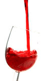 Classy party. Red wine being poured into glass royalty free stock image