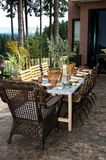 Classy Patio Dining. Image of an outdoor dining table all set for a party Stock Images
