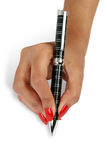 Classy pen on a female's hand Royalty Free Stock Photo
