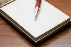 Classy pen on a notebook Stock Photography